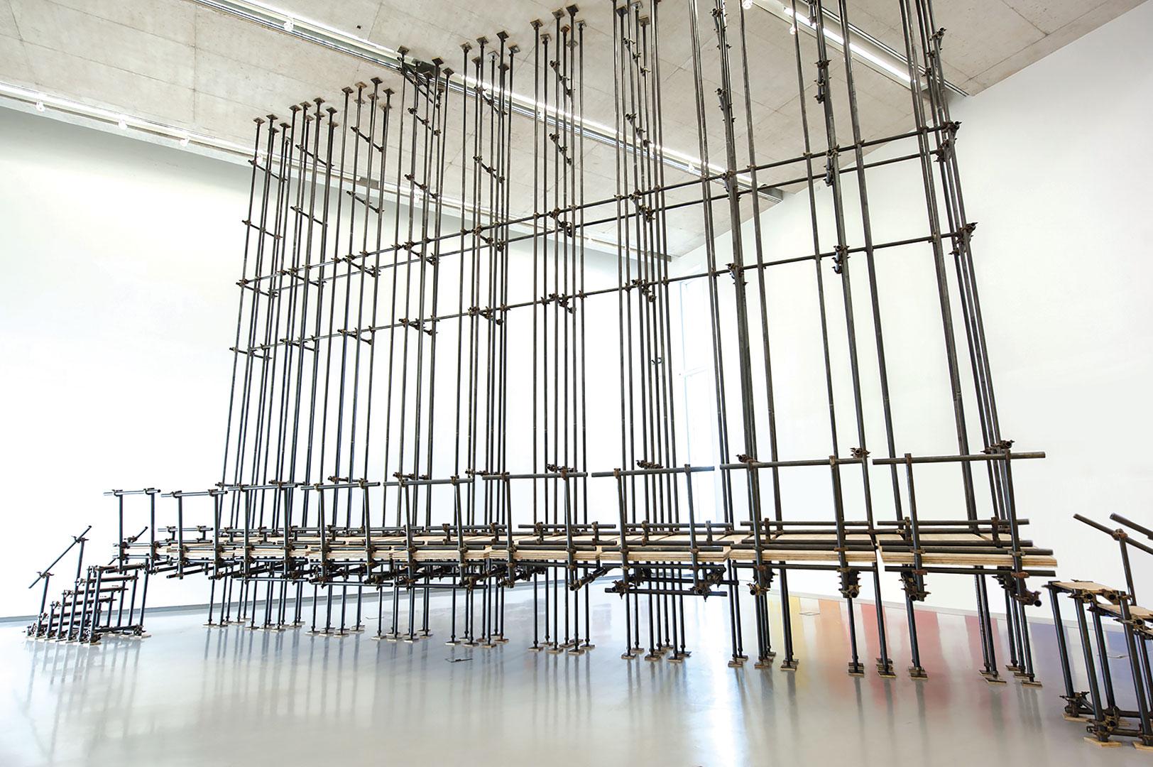Prueba de tensión | Plywood, iron pipes and scaffolding clamps | 9,00 x 2,44 x 11,6 m