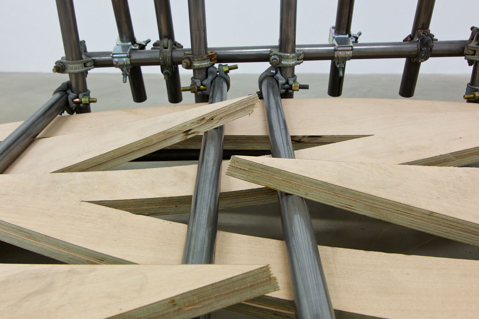 Untitled | 120 x 120 x 244 cm | Plywood, iron piping and scaffolding clumps